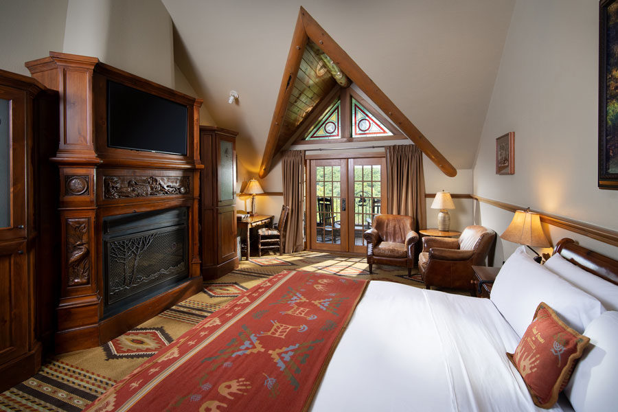 Falls Lodge Premier King bedroom with balcony lake and valley views at Big Cedar