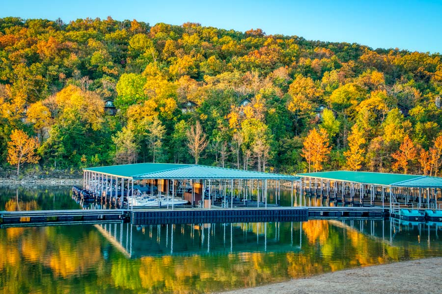 Bent Hook Marina at Big Cedar boat docks against a hillside of fall trees