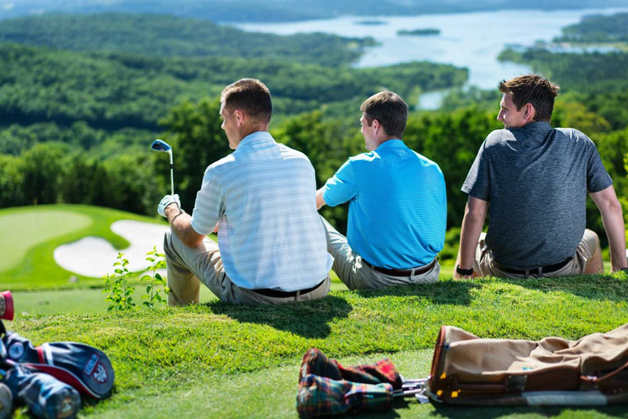 Three men taking in the views between tee offs at Big Cedar golf