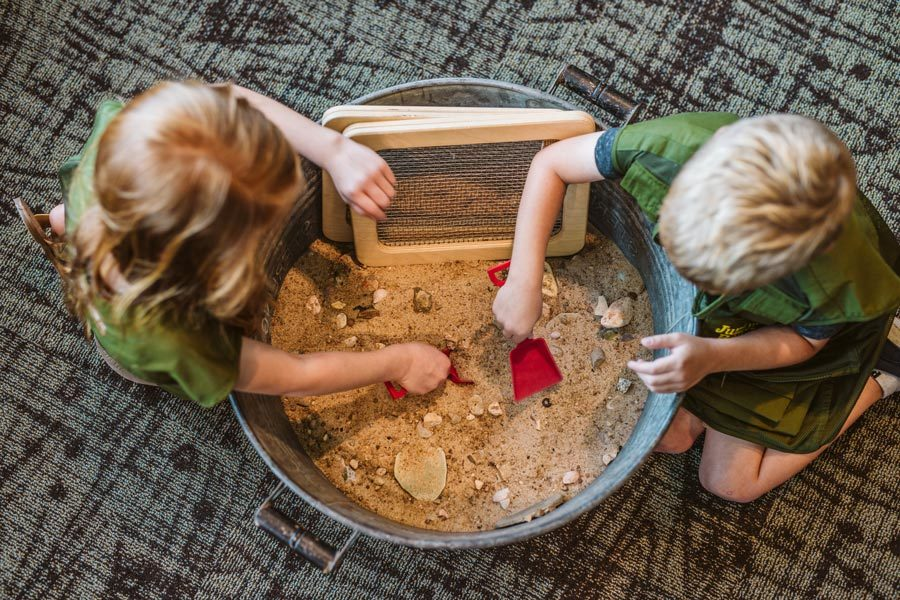 kids playing in sandbox at Kids Adventure club and daycare at Fun Mountain