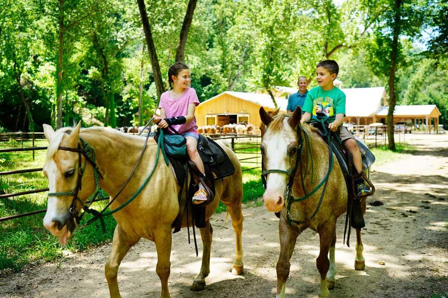 Kids horseback riding at Dogwood Canyon Nature Park at Big Cedar