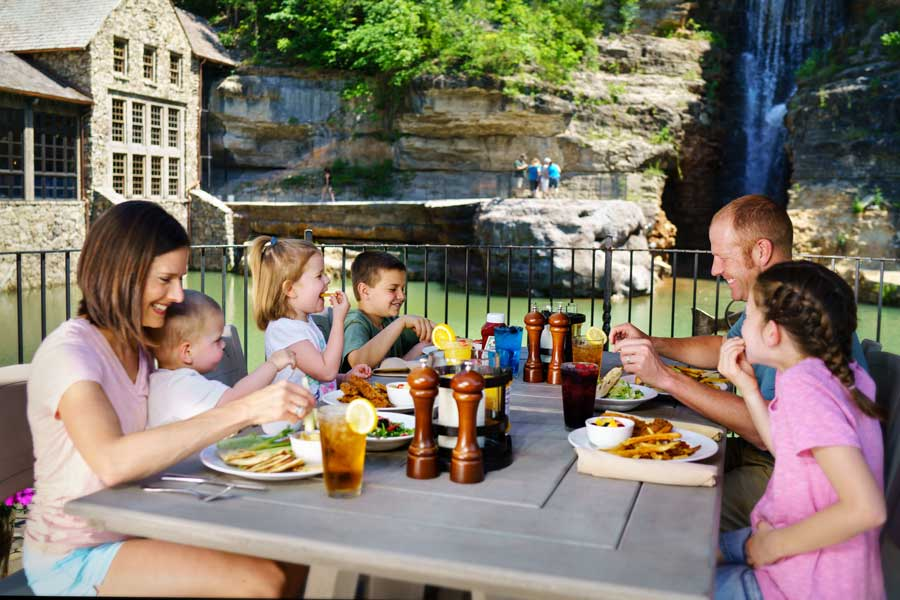 Family dining outside at the Dogwood Canyon Nature Park at Big Cedar Working Grist Mill restaurant