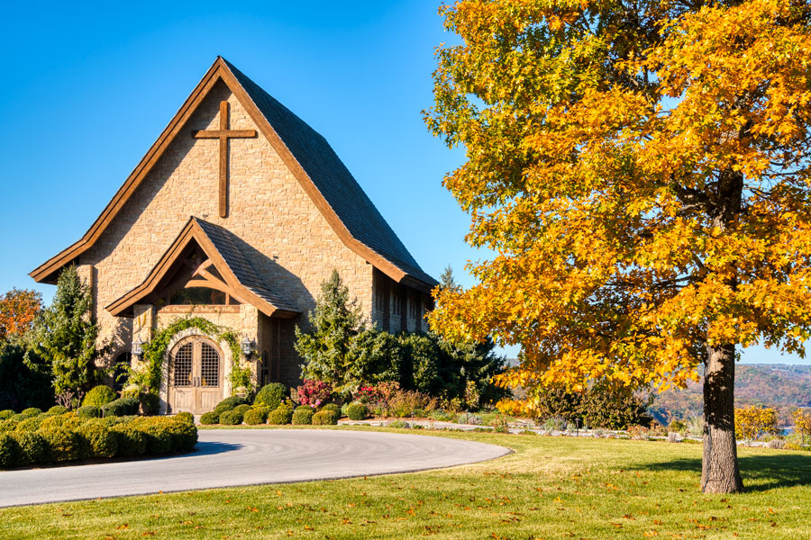 Integrity Hills Chapel in the fall with blue sky above