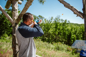 Close up of man clay shooting at Bass Pro Shops Shooting Academy at Big Cedar