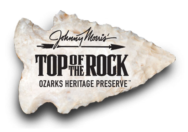 Johnny Morris' Top of the rock Ozarks Heritage Preserve logo on arrow head graphic
