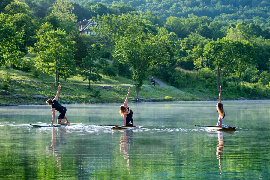 Fitness Center class doing yoga on paddle boards on Table Rock Lack at Big Cedar