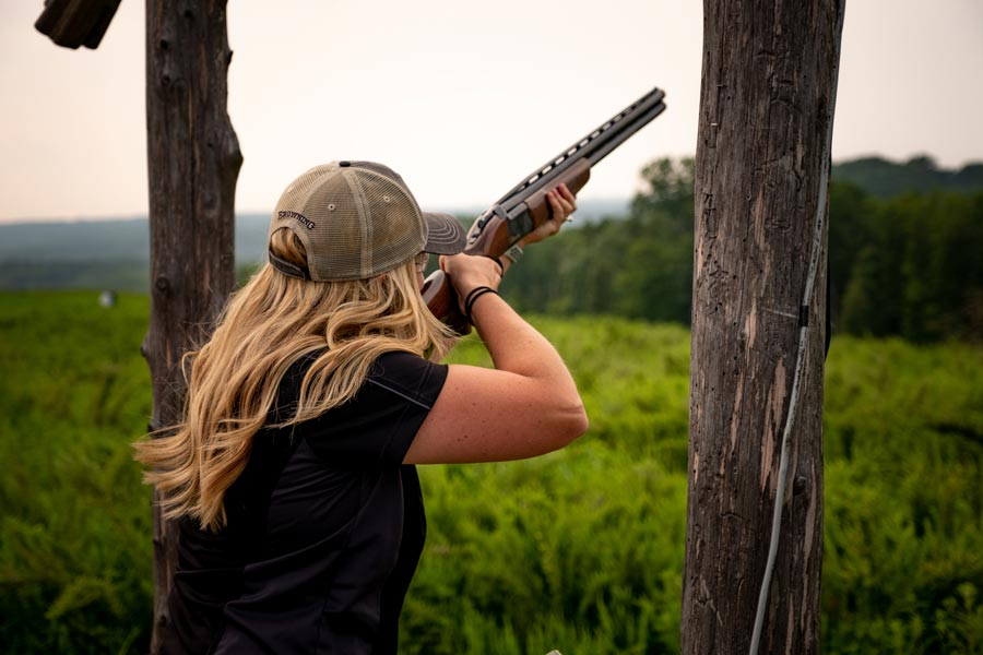 Woman shooting clays at Bass Pro Shops Shooting Academy at Big Cedar