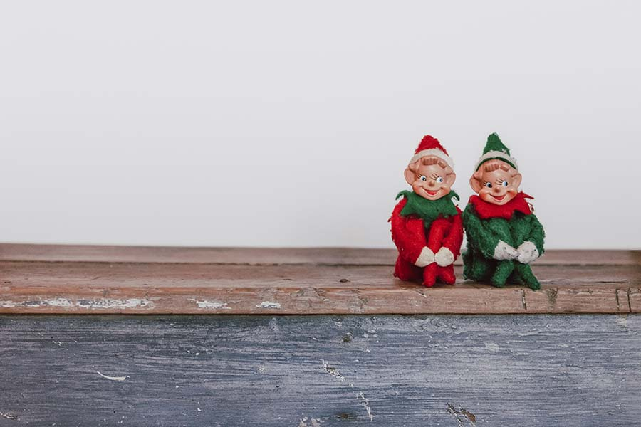 Two elf figurines on a shelf