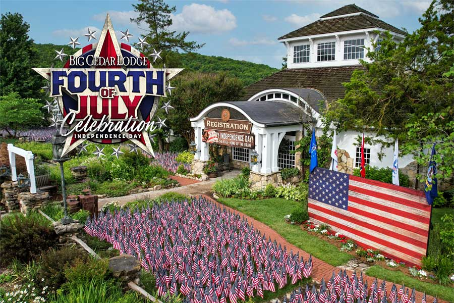 The lawn outside of the Big Cedar Lodge registration building is covered in small United States flags for a July 4th celebration