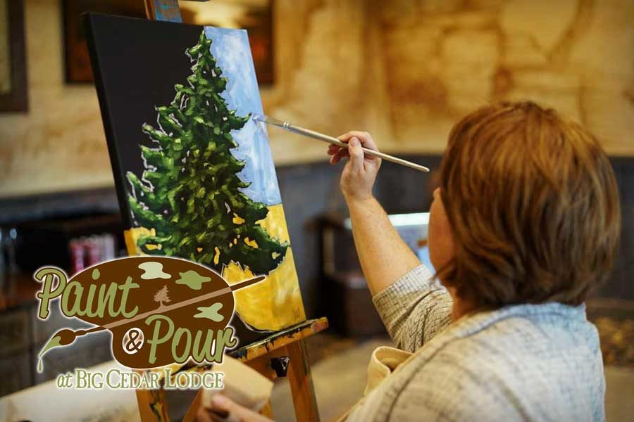 Woman painting a cedar tree at Big Cedar's Paint & Pour