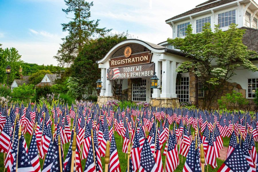 Big Cedar Lodge registration building with American flags filling the yard