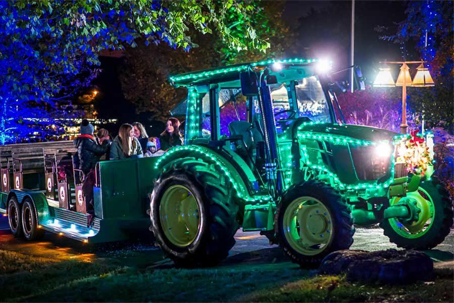 Tractor coveredin Christmas Lights driving through Big Cedar light display