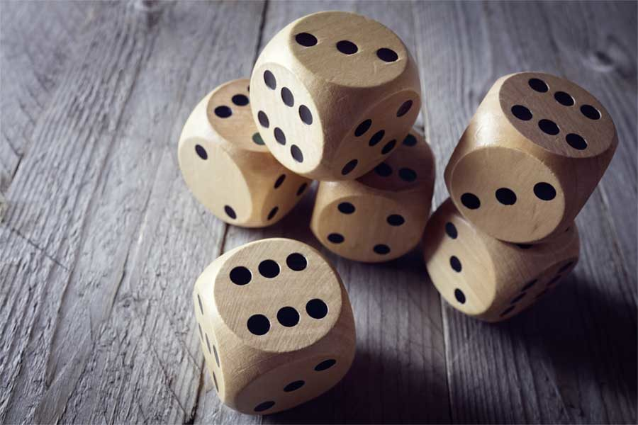 Wooden Dice Stacked on a Table