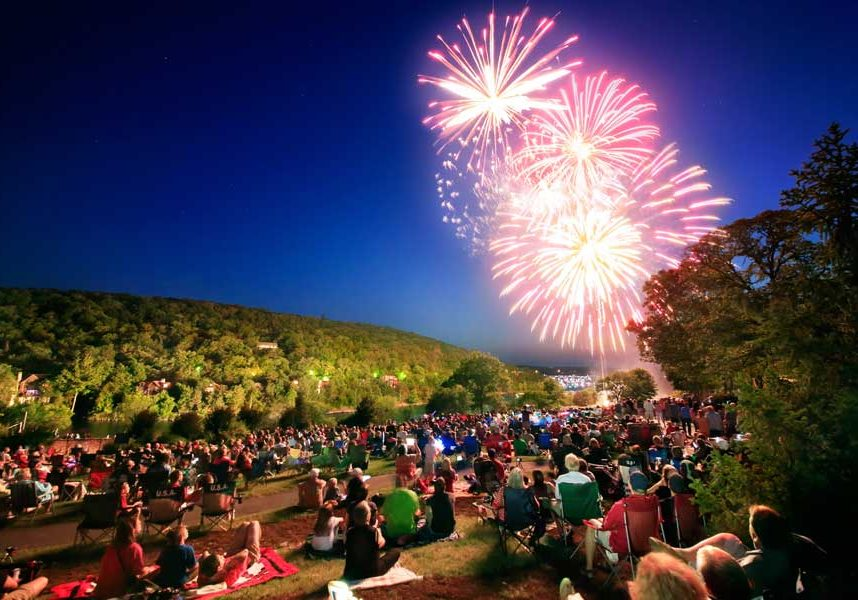 Fireworks light up the sky while people watch from the Lawn on July Fourth at Big Cedar
