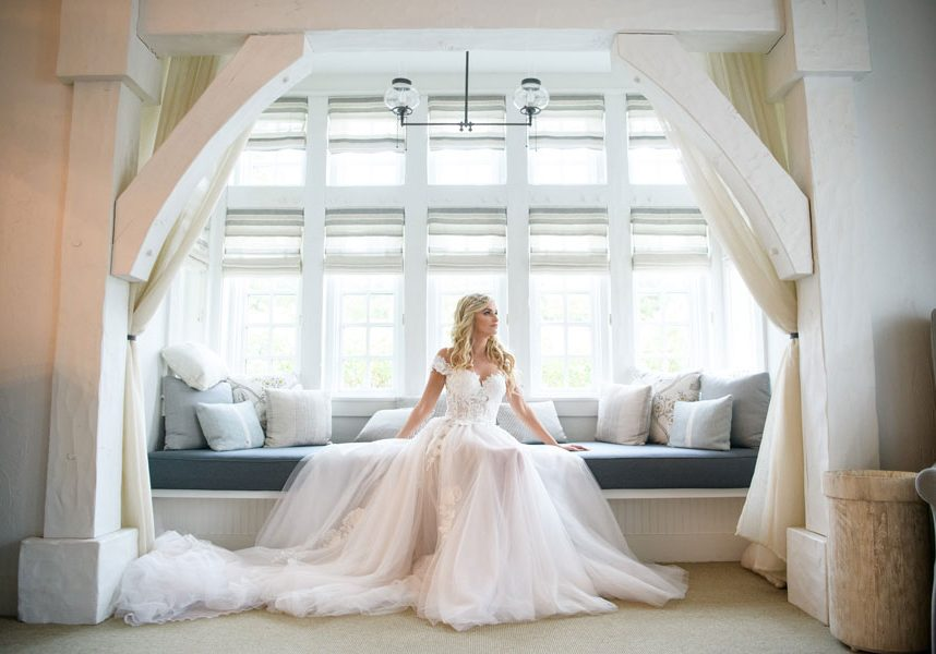 Bride posed in the archway of the bridal suite at the Cedar Creak Spa at Big Cedar Lodge