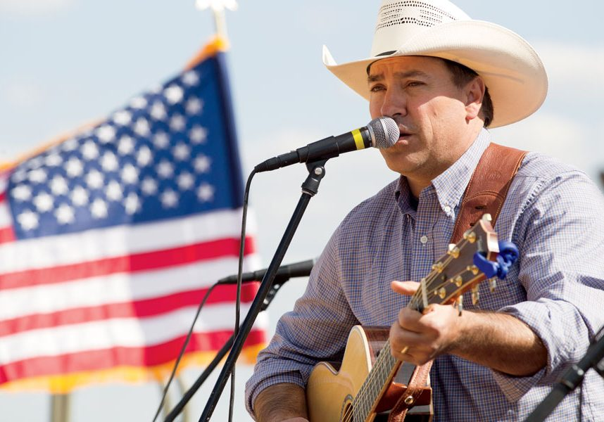 Clay Self plays guitar for a Veteran's Day event at Big Cedar Lodge