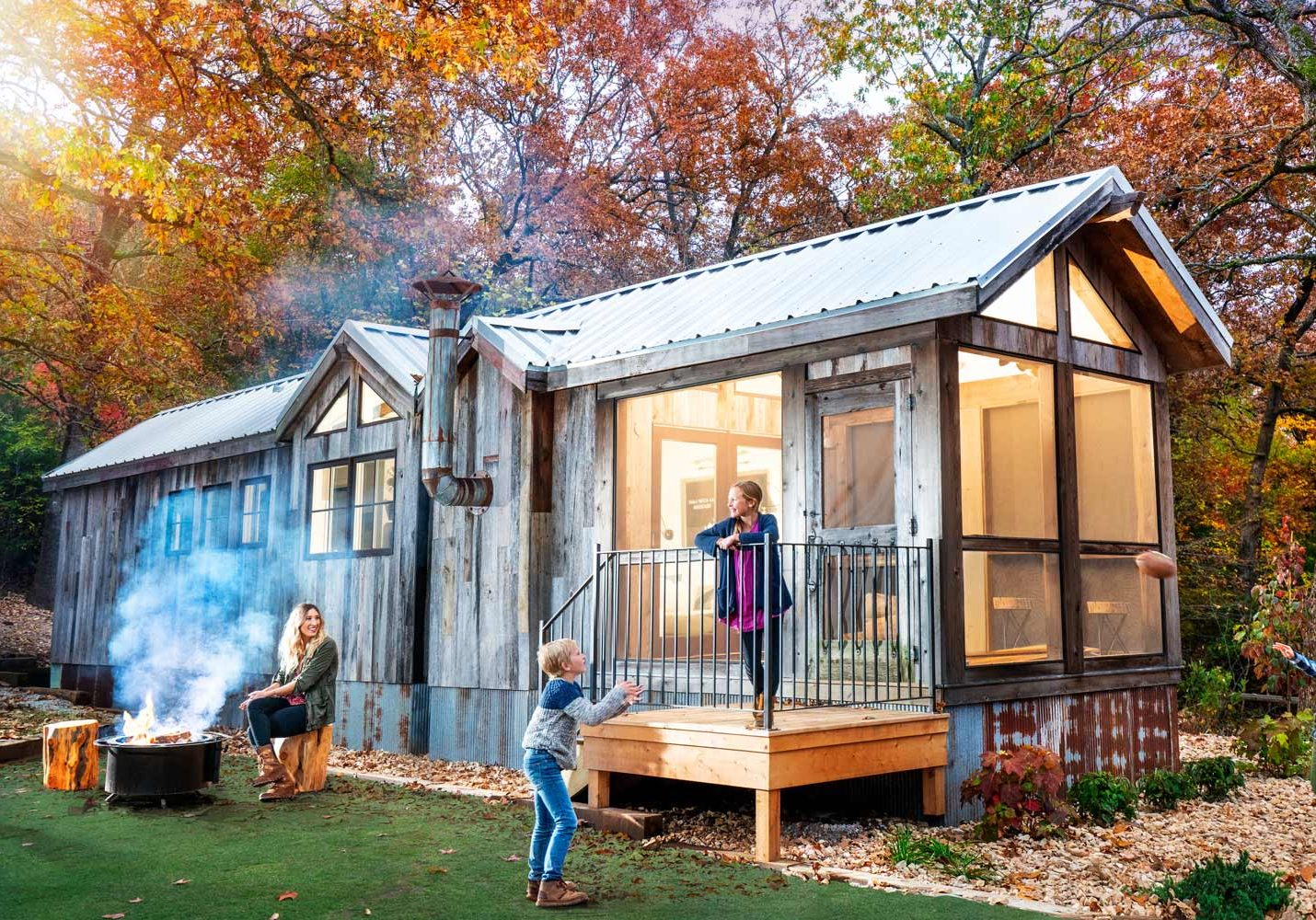 Family playing outside of their Camp Cabin at Camp Long Creek while glamping at Big Cedar Lodge